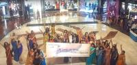 flash mob in sarees at select city walk in delhi international womens day