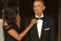 Michelle adjusting Barack  Obama Tie