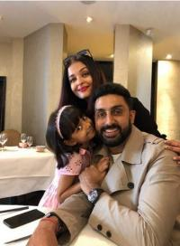 Aish and Aaradhya and Abhishek