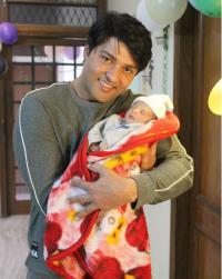 Anas Rashid and his baby daughter, Aayat