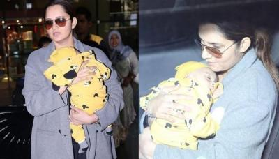 Sania Mirza Gets Papped With Baby Izhaan As He Gets Cozy In A Micky Mouse Jumper At The Airport