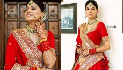 Sabyasachi Bride Created A New Trend By Opting For A Unique Red Lehenga With No Heavy Detailing