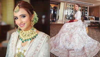 The Bride Opts For A Unique White 'Lehenga' With Fuschia Pink 'Chooda' And 'Doli Kaleeras'