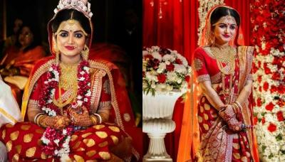 The Bengali Bride Donned A Traditional 'Laal' Saree From The Famous Designer, Sabyasachi Mukherjee