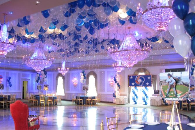 Use balloons to brighten a plain ceiling by combining them with chandeliers that compliment the balloons.