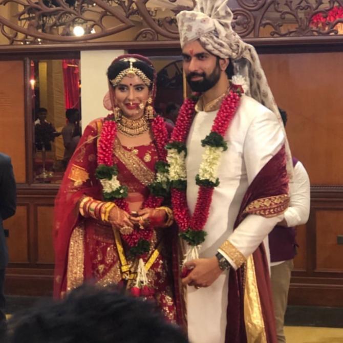 Charu and Rajeev as bride and groom