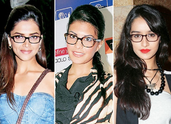 #5. Wearing dark-rimmed glasses
