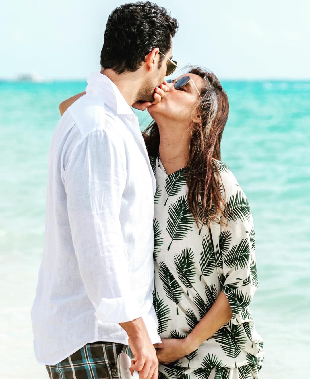 Angad Bedi Holds Pregnant Neha Dhupia Hands