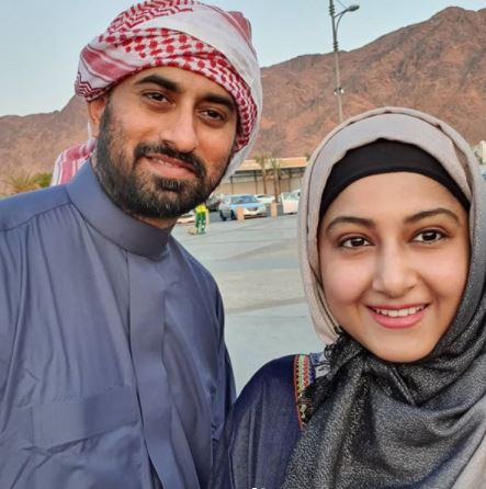 Anjum Farooki and her husband