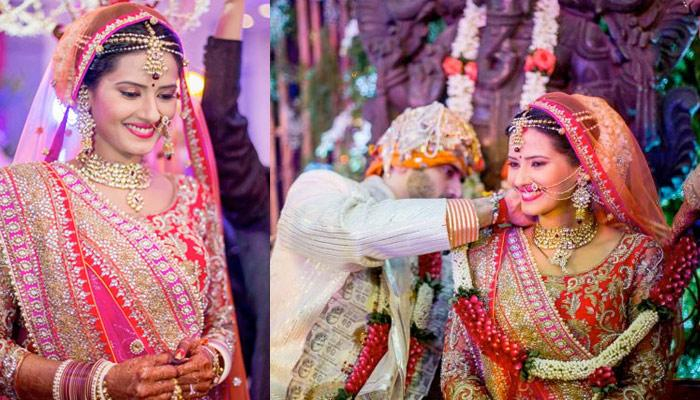 Nikitin & Kratika Had An Arranged Marriage; Kratika Had Royal Bridal Look In Red Pink Orange Lehenga